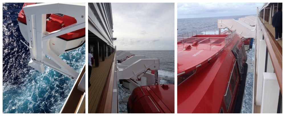 Lifeboats hang over the side on Norwegian Escape